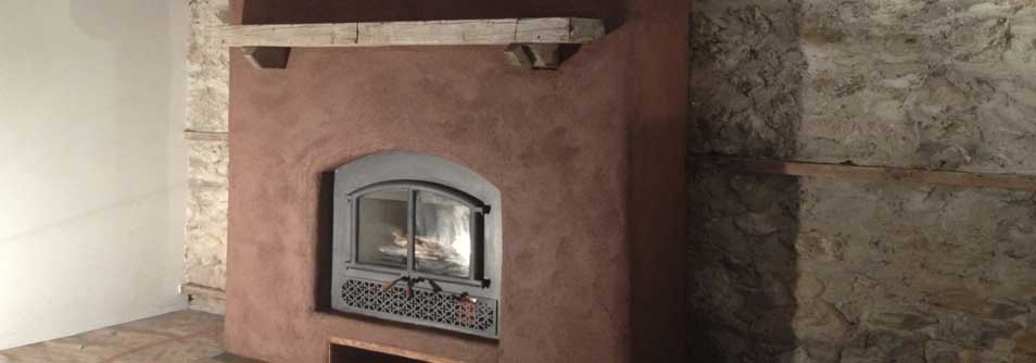 Earthen fireplace surround and natural stone wall